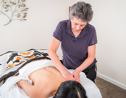 application of therapeutic massage, massage session, amherst office, northampton office